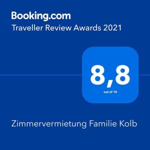 Ett certifikat, pris eller annat dokument som visas upp på Zimmervermietung Familie Kolb