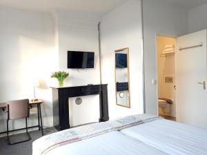 Een bed of bedden in een kamer bij Hotel Verdi