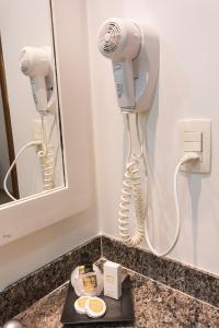 Um banheiro em Hotel Ilhas da Grécia