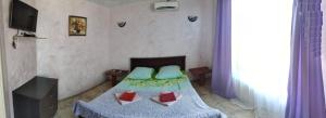 A bed or beds in a room at Guest House Gostevoy dvor