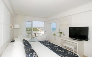 A television and/or entertainment center at Insotel Hotel Formentera Playa