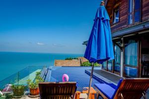 The swimming pool at or close to Sandalwood Luxury Villa Resort