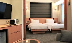 A bed or beds in a room at South Pacific Hotel
