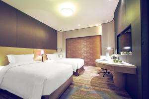 Ein Bett oder Betten in einem Zimmer der Unterkunft Hotel Equatorial Shanghai