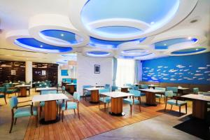 A restaurant or other place to eat at Grand Dafam Ancol Jakarta