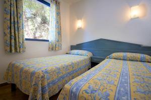 Ein Bett oder Betten in einem Zimmer der Unterkunft Insotel Club Maryland - All Inclusive