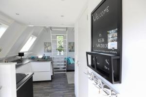 Een TV en/of entertainmentcenter bij Appartement Klein Waldeck