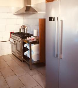 A kitchen or kitchenette at Butterfly Lodge