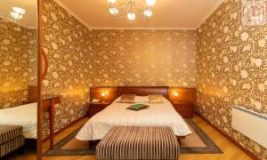 A bed or beds in a room at Zvenigorod Resort Merii