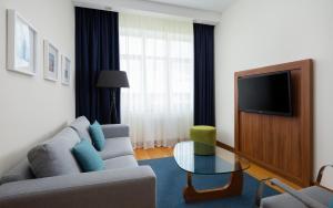 Гостиная зона в Radisson Residences, Zavidovo