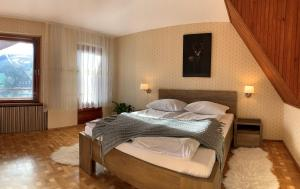 A bed or beds in a room at Pensjonat Paradise