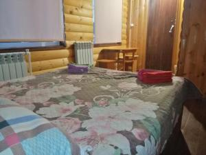 A bed or beds in a room at Guesthouse Pushkina