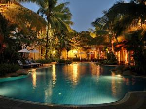 The swimming pool at or near Settha Palace Hotel
