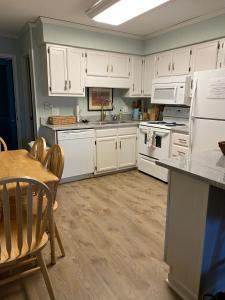 A kitchen or kitchenette at Matilda's at Ocean Forest Villas