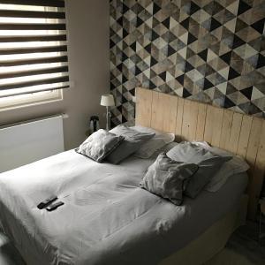 Un ou plusieurs lits dans un hébergement de l'établissement Chez Marianne