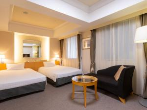 A bed or beds in a room at Rihga Hotel Zest Takamatsu