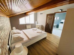 Кровать или кровати в номере Апарт-Отель SP Apart Lenina