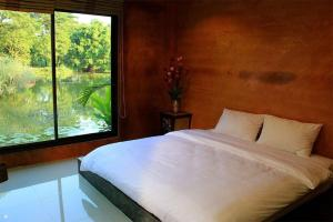 A bed or beds in a room at Saikaew Resort