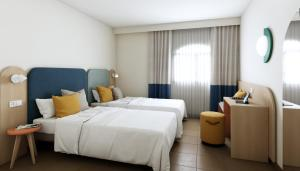 A bed or beds in a room at HD Parque Cristobal Gran Canaria