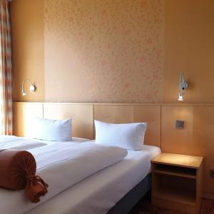 A bed or beds in a room at Landhotel Rittmeister