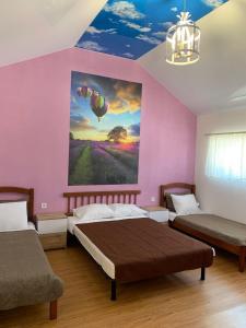 Кровать или кровати в номере Guest House Shafran