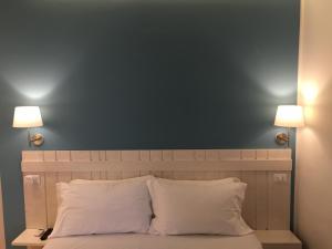 Letto o letti in una camera di B&B Medinblu
