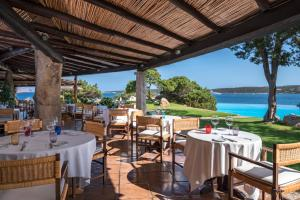 A restaurant or other place to eat at Pitrizza, a Luxury Collection Hotel