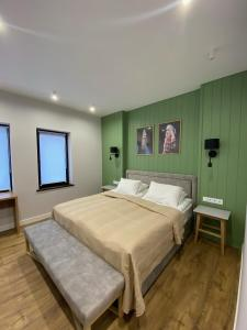 A bed or beds in a room at Chudodiyevo Park- Hotel