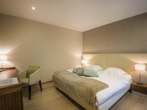 Ein Bett oder Betten in einem Zimmer der Unterkunft Au Vieux Moulin