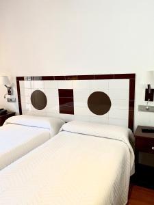 A bed or beds in a room at Complejo Turístico La Garganta