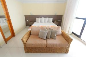 A bed or beds in a room at Tropical Executive Hotel