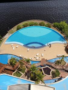 A view of the pool at Tropical Executive Hotel or nearby