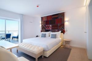 A bed or beds in a room at Royal Obidos Evolutee Hotel