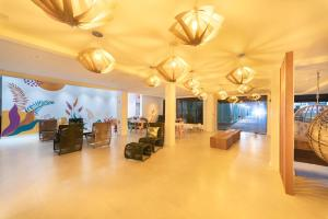 The lobby or reception area at Rizzu Marina Hotel