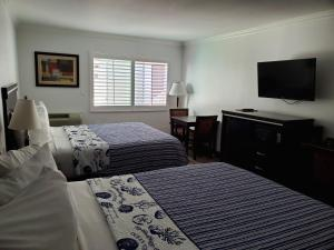A bed or beds in a room at Ocean Surf Inn & Suites