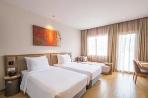 Giường trong phòng chung tại Minera Hot Springs Binh Chau