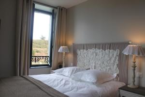 A bed or beds in a room at Villa Pen Prad