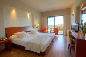 A bed or beds in a room at Valle Del Este Golf Resort