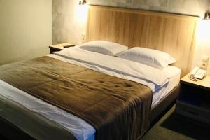 Кровать или кровати в номере Бутик отель Печора