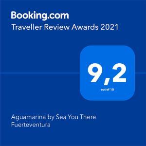 Certificado, premio, señal o documento que está expuesto en Aguamarina by Sea You There Fuerteventura