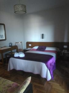 A bed or beds in a room at Hostal Solpor