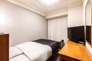 APA Hotel Kyoto Gion Excellent房間的床