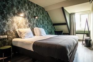 Ein Bett oder Betten in einem Zimmer der Unterkunft Hotel het Anker van Texel