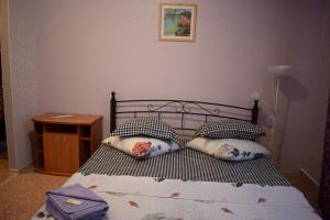 Кровать или кровати в номере Мини Отель Манго