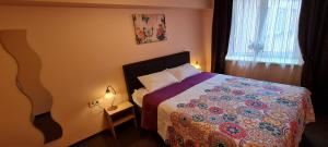 A bed or beds in a room at Apartamentai Vyta
