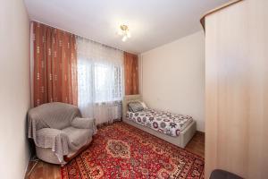 A seating area at YourHouse Микрорайон Аксай-1, дом 17