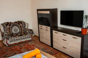 A television and/or entertainment center at YourHouse Микрорайон Аксай-1, дом 17