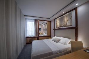 Krevet ili kreveti u jedinici u okviru objekta Tulip Inn Putnik Belgrade