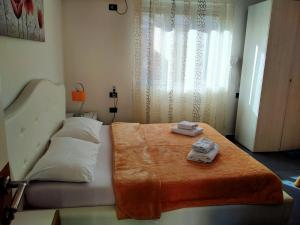 A bed or beds in a room at Orange Villa Hotel