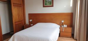 A bed or beds in a room at Sori Apartments